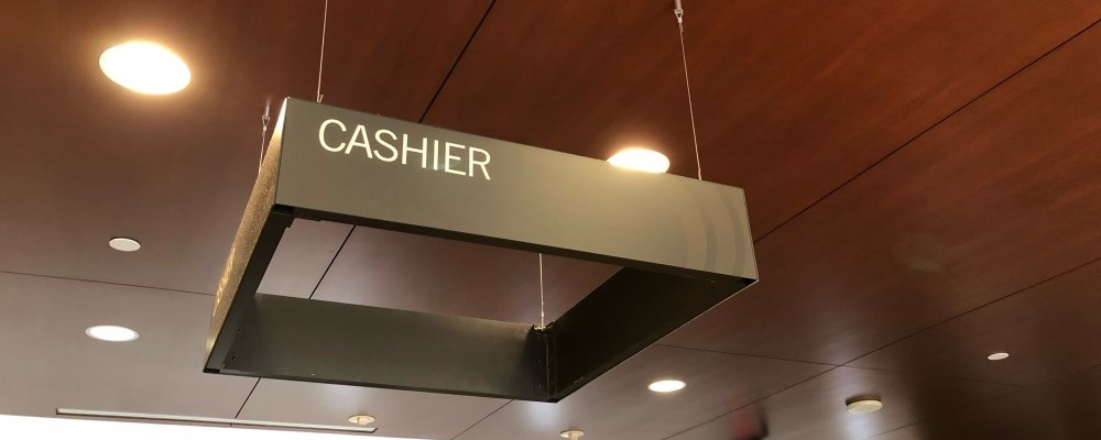 Cashier sign at the front counter of Durham Region Headquarters