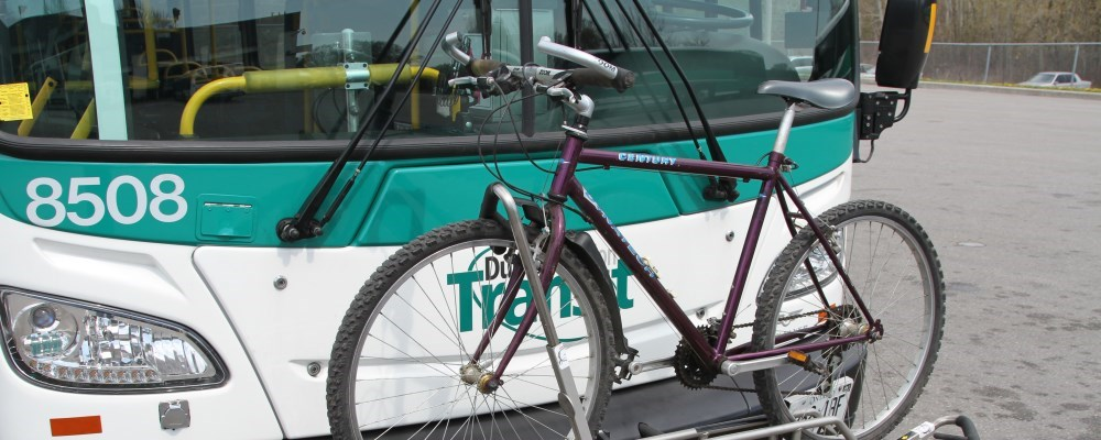 Bike on a bike rack on the front of a bus